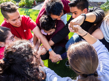 Eight students particpate in a group exercise called the human knot.